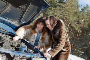 women with   breakage car at winter road