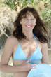 Happy smiling mature woman wearing bikini