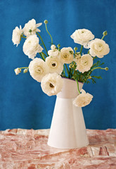 White Ranunculus in a flower vase .