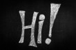 """Hi"" written on a black chalkboard"
