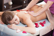 .Woman enjoying a massage in a spa setting