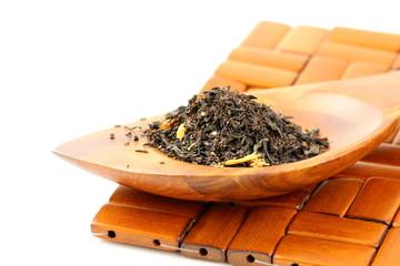 fragrant black tea in wooden spoon