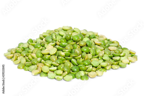 Pile split green peas isolated on white background.