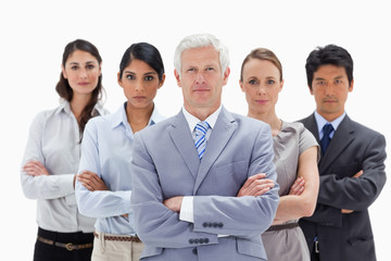 Close-up of a multicultural business team behind their boss