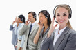 Smiling professionals listening with headsets