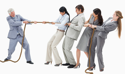 Boss pulling a rope against his employees