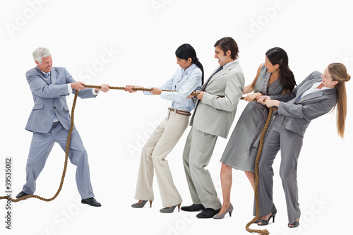 Business people pulling a rope against their boss