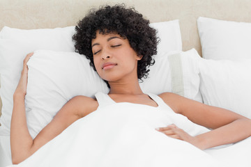 Curly haired woman sleeping peacefully
