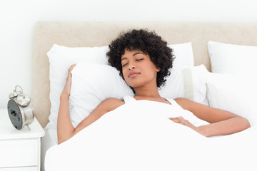 Woman with curly haired sleeping peacefully