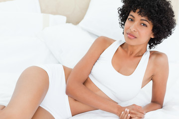 Portrait of a sexy woman on her bed