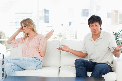 Man is confused as he does not know what to do and the woman is uninterested
