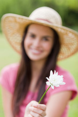 Beautiful white flower held by an attractive woman