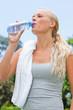 Sportswoman drinking a bottle of water