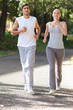 Sportspeople jogging on an avenue