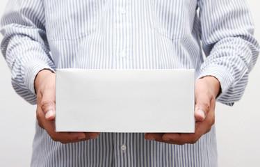 Man hold white paper box