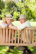 Close-up of two friends embracing each other on a bench