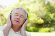 Man with his eyes closed thoughtfully listening to music