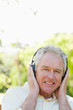 Close-up of a man smiling while listening to music