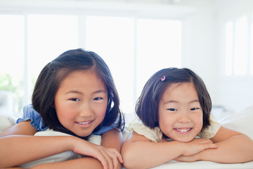 Both girls face forward while smiling