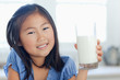 Close up of a girl smiling with a glass of milk
