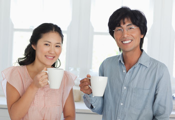 A couple enjoying their cups of coffee