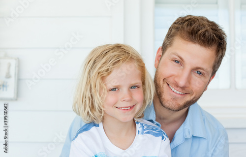 Close up of a son and his dad smiling