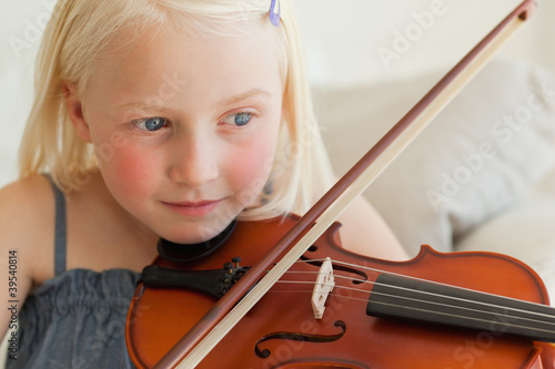 A girl practises on the violin