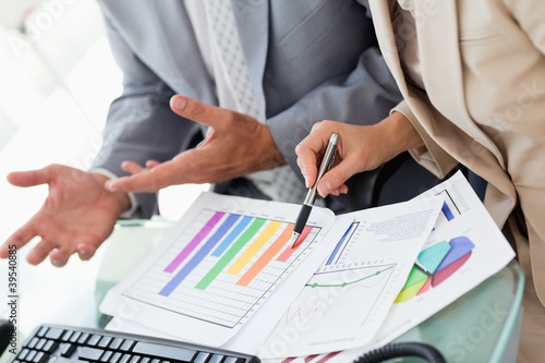 Business people working on statistics