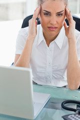 Portrait of a businesswoman with headache