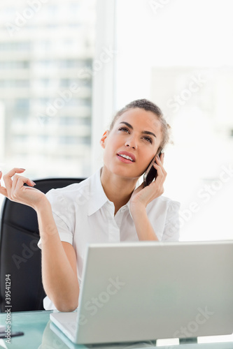 Tanned businesswoman having a conversation on phone