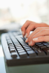 Close-up of a woman hands typing on a keyboard