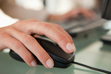 Close-up of a woman hand moving a mouse