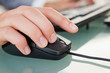 Close-up of man hand clicking with a mouse