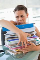 Upset businesswoman getting too much work