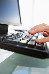 Close-up of man hands typing on a keyboard