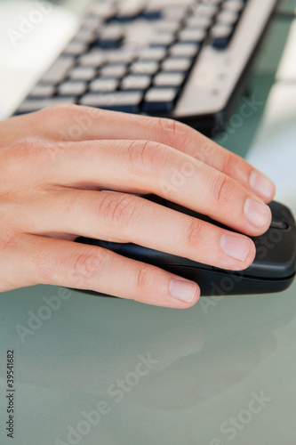Close-up of man's hand moving a mouse