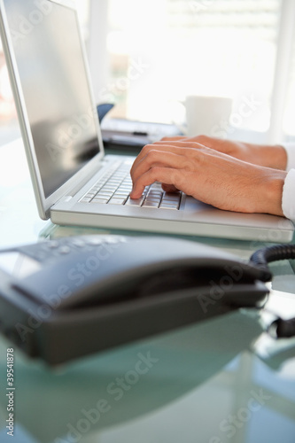 Close-up of businessman hands on a laptop