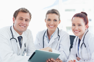 Doctors with tablet computer