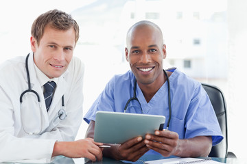 Two doctors with tablet computer