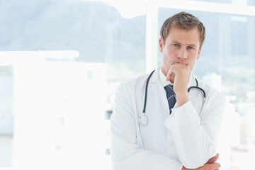Doctor in thinkers pose