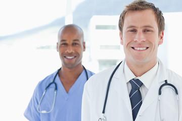 Smiling doctors standing in line