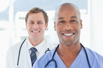 Smiling doctors standing in a row