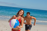 Close-up of a cute couple playing with a beach ball
