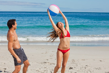 Attractive woman catches the ball