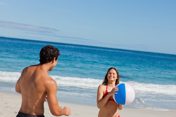 Close-up of a couple playing with a beach ball