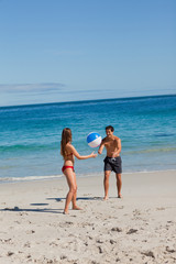 Couple playing with a beach ball