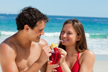 Tanned couple drinking a cocktail