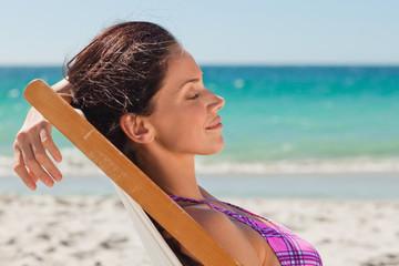 Woman in bikini taking a sunbath