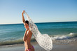 Portrait of an attractive woman holding her sarong in the air