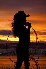 cowgirl holding rope